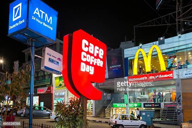 Colorful illuminated commercials at Mahatma Gandhi Road MG Road one of the city's amusement spots seen at night