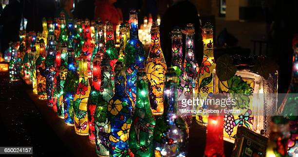 Colorful Illuminated Lighting Decoration On Bottles At Night