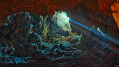 Colorful illumination in Dau Go cave in Halong Bay, Vietnam