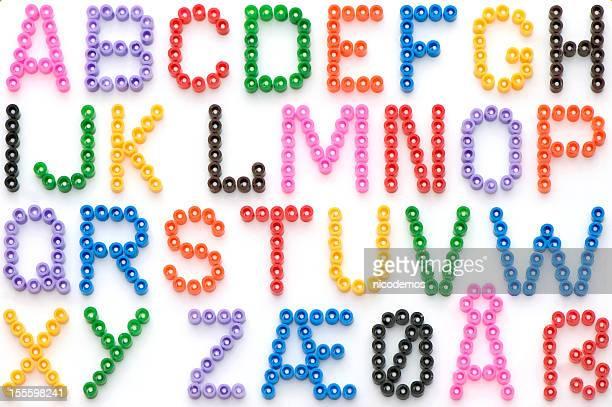 Alfabeto colorato perline in tedesco