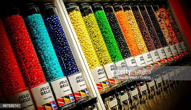 Colorful Jellybeans In Glass Bottles At Candy Shop