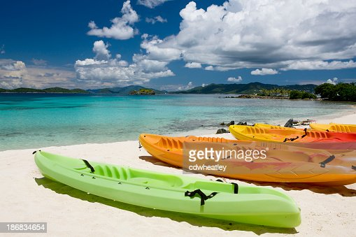 colorful kayaks on a beach in the Virgin Islands