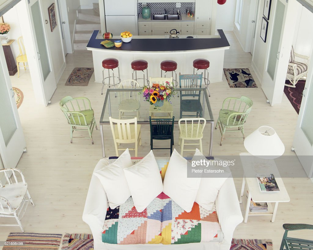 colorful kitchen and living room with island dining table and