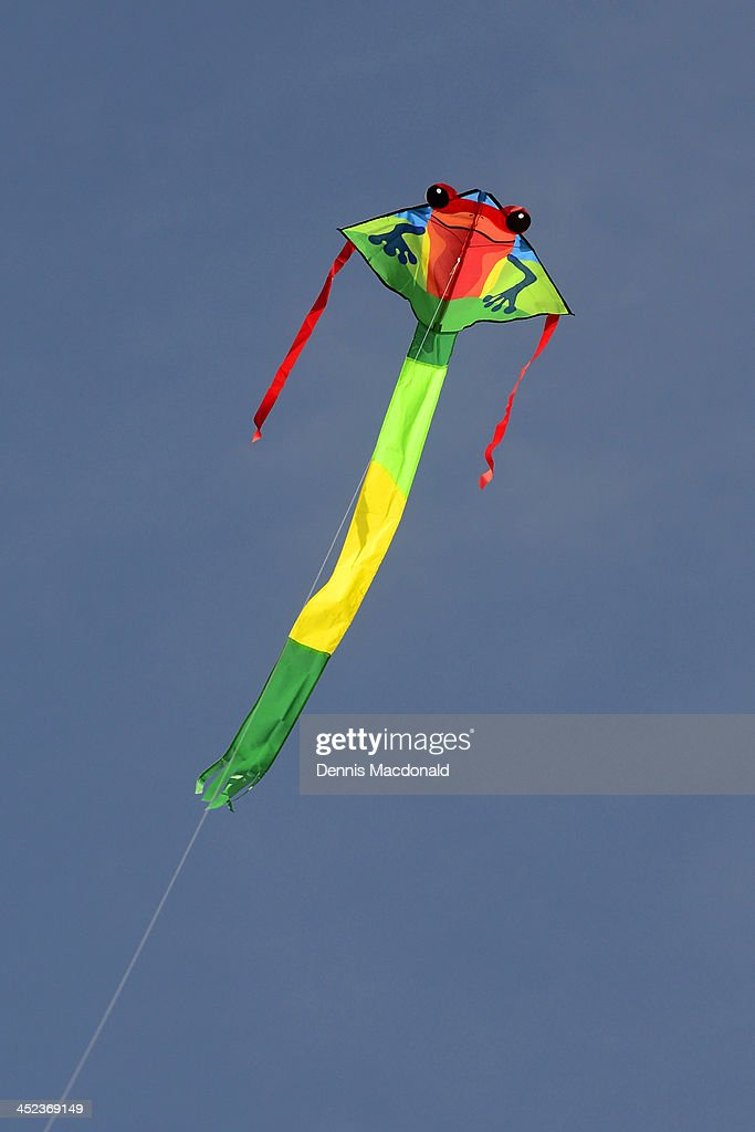 Colorful kite against blue sky : Stock Photo