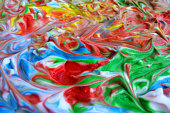 Colorful landscape made out from a shaving foam. Abstract background and texture.