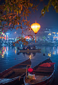 Colorful lanterns light up the riverbank in the picturesque historic city of Hoi An, Vietnam. Every year this popular tourist town is decorated with colorful lanterns during Tet, the Vietnamese New Ye