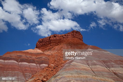 Colorful layered rock formations; sky beyond : Stock Photo