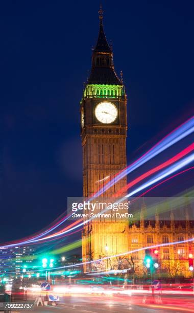 Colorful Light Trails On Road By Illuminated Big Ben At Night