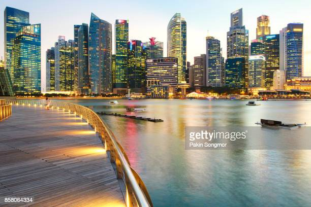 Colorful lights architecture business building and financial district in sunset time at Singapore City.