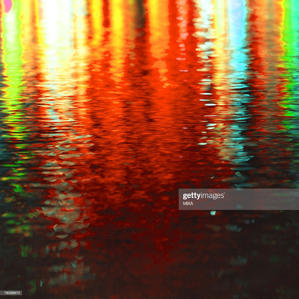 Colorful lights reflected on water surface : Stock Photo