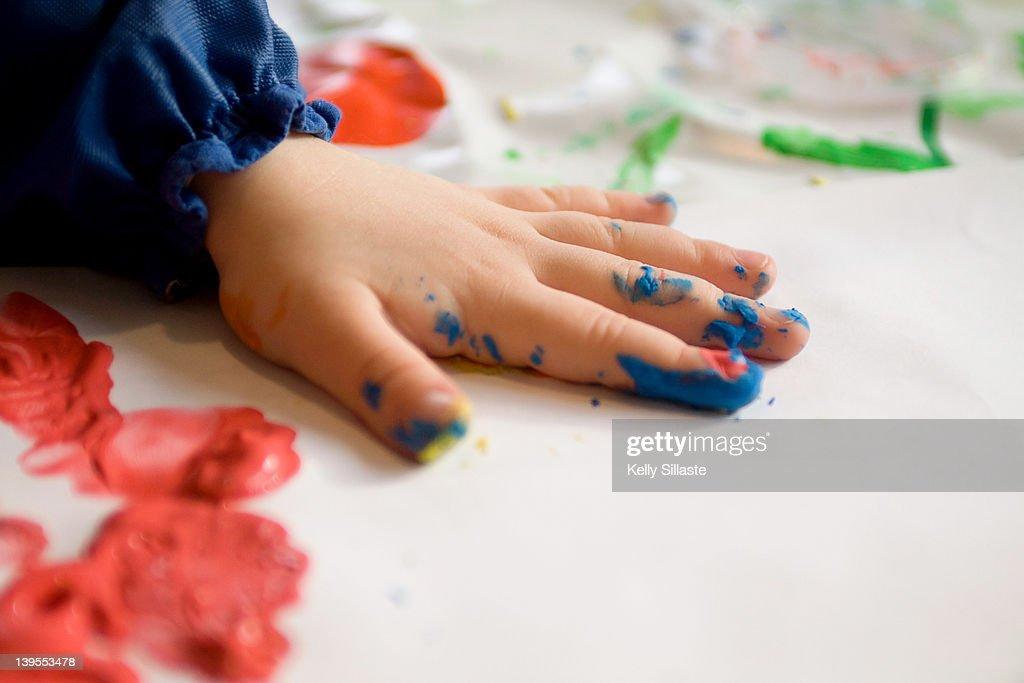 Colorful little fingers with finger paint : Stock Photo