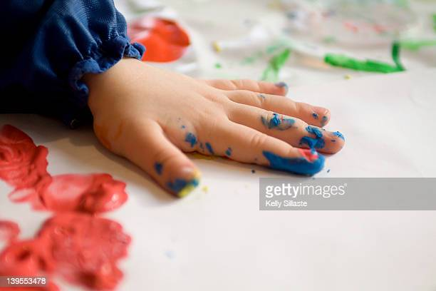 Colorful little fingers with finger paint