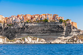 Colorful living houses on rocky coast of Bonifacio, mountainous Mediterranean island Corsica, Corse-du-Sud, France