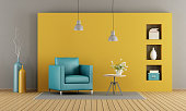 Colorful living room with armchair and coffee table - 3d rendering