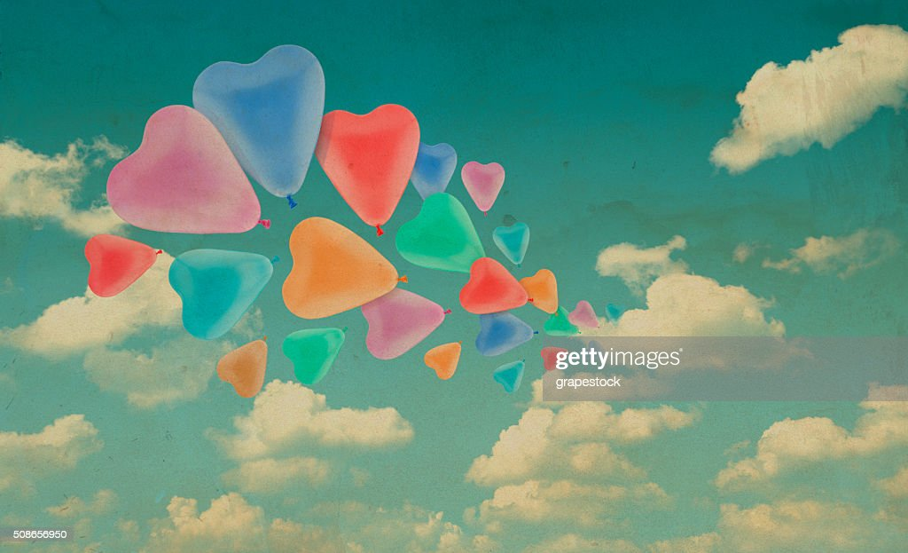 Colorful love heart balloon on blue sky background, vintage style : Stock Photo