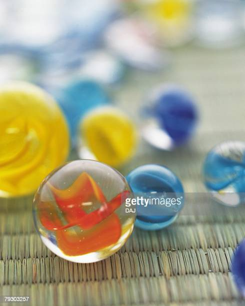 Colorful marbles on Tatami mat, high angle view, differential focus