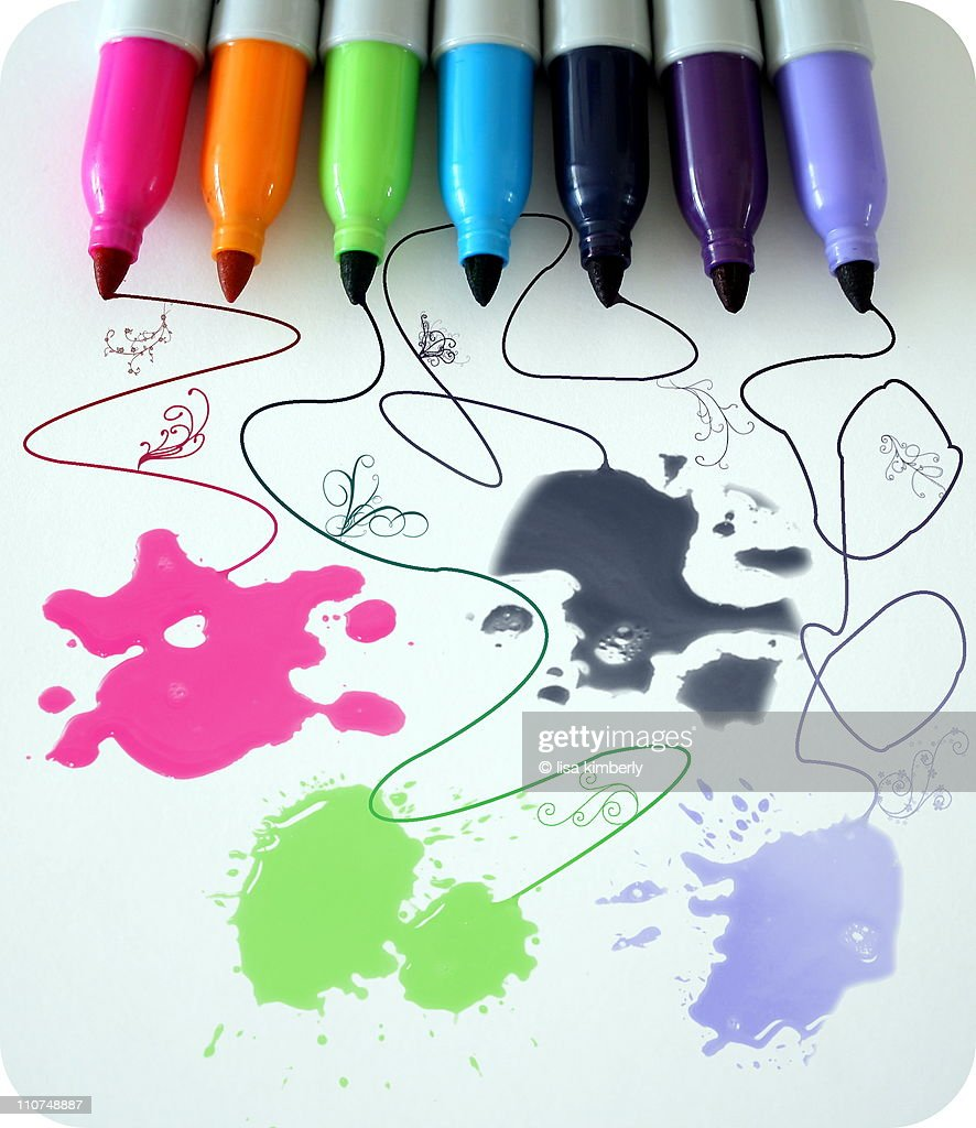 Colorful markers with ink blots : Stock Photo
