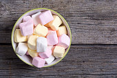 Colorful marshmallow in bowl background . White , pink and yellow