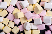 Colorful marshmallow background . White , pink and yellow