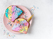 Colorful mermaid and unicorn toast with decoration on white background