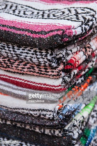 Colorful Mexican serapes hang in row. : Stock Photo
