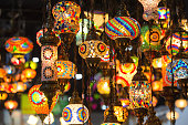 Colorful Moroccan style lanterns lamp hanging down from ceiling.