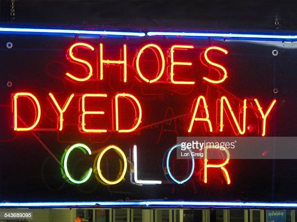 Colorful Neon Shoe Sign at night in Houston Texas