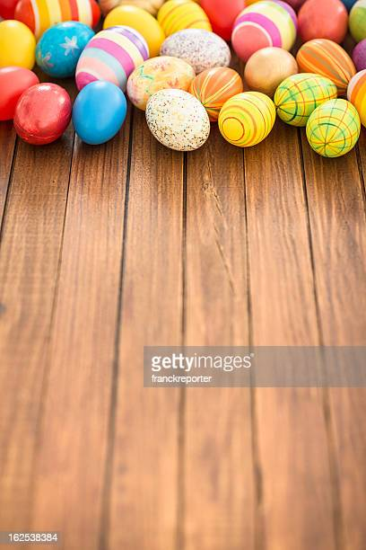 Colorful painted easter egg background on wood