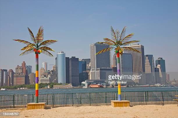 Colorful palm tree fixtures and Lower Manhattan.