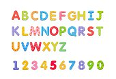 Colorful paper alphabet magnets on a whiteboard. Letters set isolated on white background