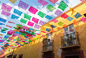Colorful paper flags over street in San Miguel de Allende Mexico