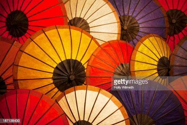 Colorful paper umbrellas open together
