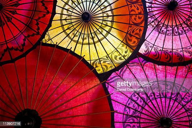 Colorful paper umbrellas top view