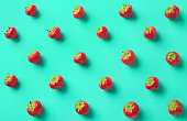 Colorful pattern of strawberries on blue background. From top view