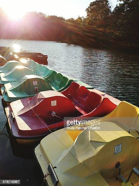 Colorful Pedal Boats Moored In Lake