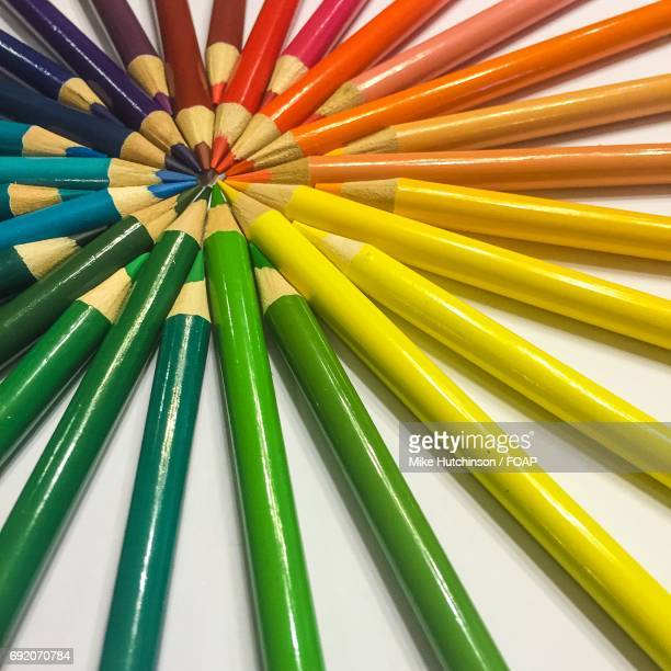 Colorful pencils arranging on white background