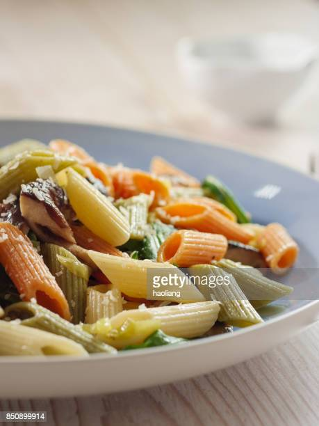 Colorful penne pasta with wild mushroom