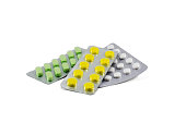 Colorful pills strips isolated on white background