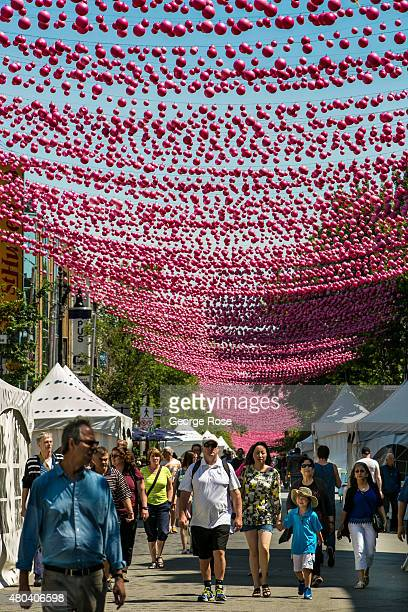Colorful pink bubble ornaments create a canopy along SainteCatherine Street in Montreal's Gay Village district on June 30 2015 in Montreal Quebec...