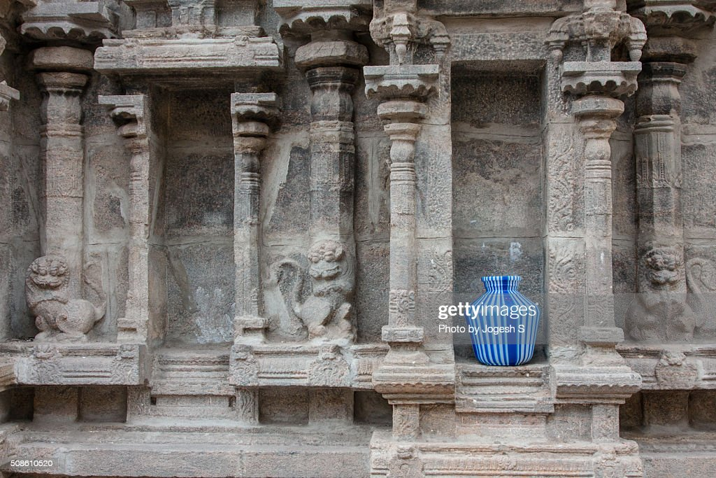 A colorful pot in an ancient temple wall : Stock Photo