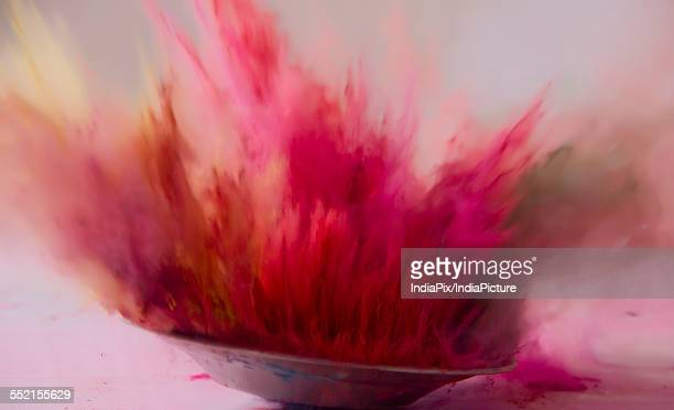 Colorful powder splashing during Holi festival