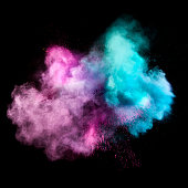 Colorful powders on black background