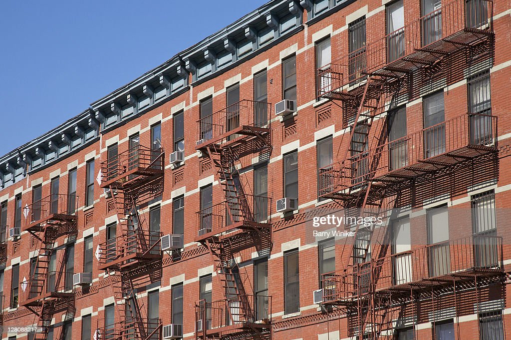 Nice Colorful Red Brick Apartments With Fire Escapes On West 125th Street,  Harlem, New York