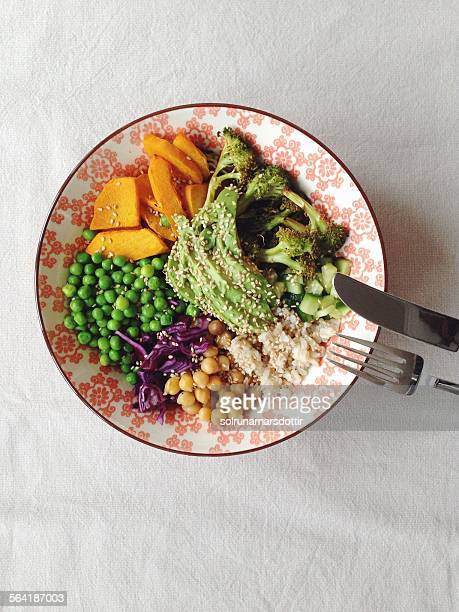 Colorful salad bowl with vegetables and rice