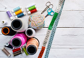 Sewing and knitting items, threads, measuring tape and scissors, colorful and organized