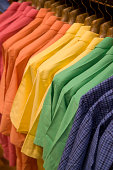 Colorful shirts on a rack ready for spring.