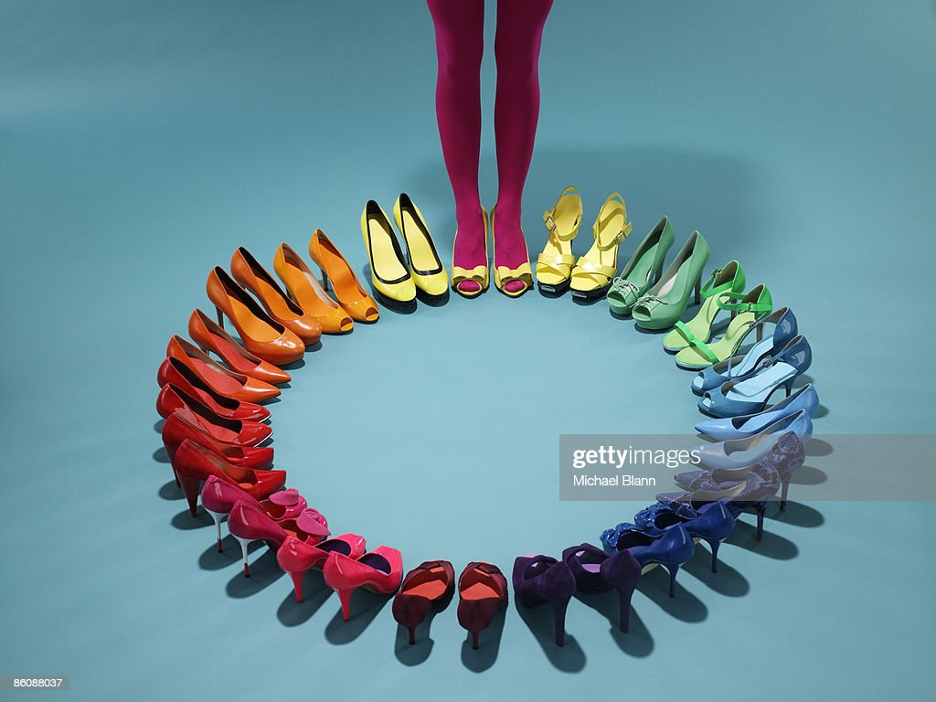 Colorful shoes form a color wheel with legs : Bildbanksbilder