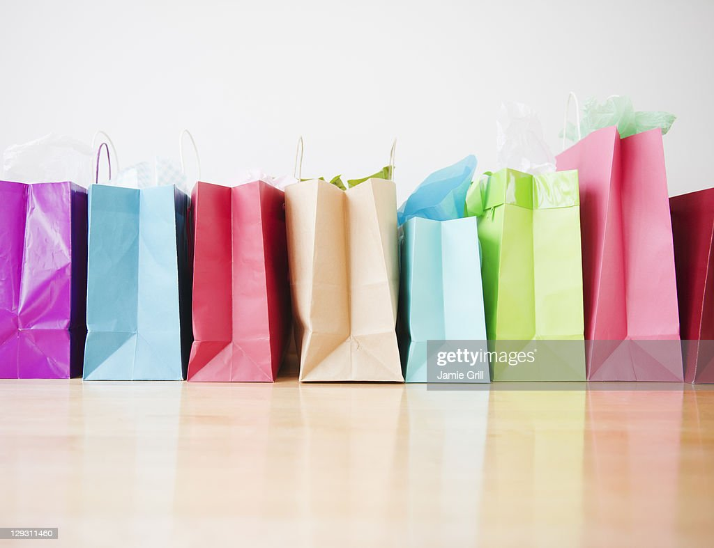 Colorful shopping bags standing in row : Stock Photo