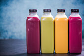 Colorful and vivid smoothies in plastic bottles