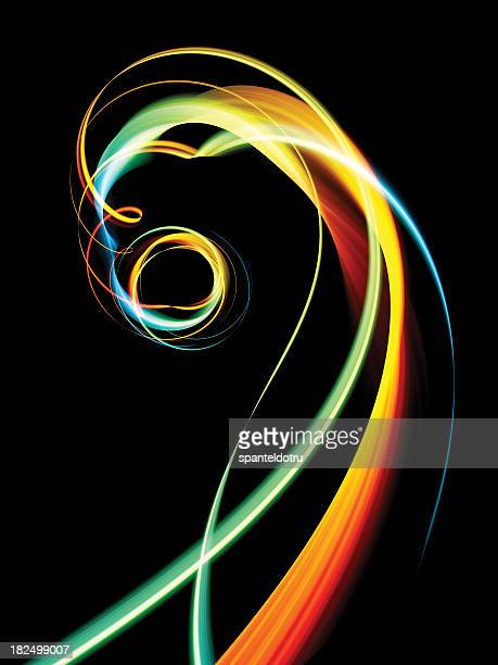 Colorful spiral waves in front of a black background